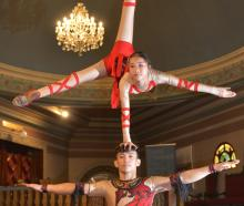 Wuhan Acrobatic and Cultural Troupe performer Lingzhi Mi balances on fellow performer Yanbao Lyu...