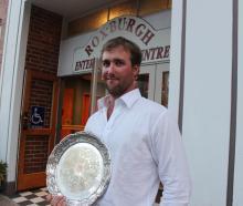 Nigel Woodhead, of Milton,  displays the Young Farmer  Otago-Southland regional final plate he...