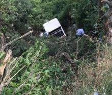A tourist bus has crashed down a hill near Akaroa. Photo: NZ Herald