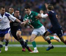 Ireland's Conor Murray takes on the French defence. Photo Getty