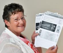 Sue Cousins, of Dunedin, with her Bruce Springsteen tickets. PHOTO: PETER MCINTOSH