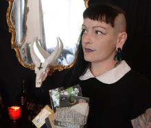 Satanic New Zealand co-founder Frankie Vegas with some of the clothing collected for the  ''Soles...