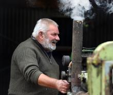 Ray Elfield, of Mosgiel, starts a Ruston Hornsby diesel engine during an open day at the Taieri...