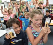 Kaikorai Primary School pupils Tiaki Herewini and Isla Marshall (both 6) hold a couple of the...