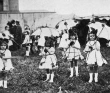 The Normal School baby team, who were first in the fancy dress competition at the Red Cross...