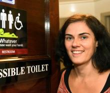 Regent Theatre marketing manager Hannah Molloy at the new all-inclusive toilet sign at the...
