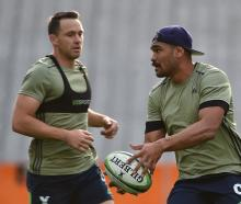 Highlanders fullback Ben Smith (left) and winger Patrick Osborne train at Forsyth Barr Stadium in...