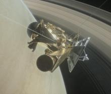 This illustration of Nasa's Cassini spacecraft about to make one of its dives between Saturn and its innermost rings. Photo: Reuters