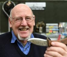 Selwyn Shanks holds the first knife he made, which led to a more than 30-year involvement in...