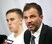 Anthony Hudson addresses the media with Ryan Thomas earlier this year. Photo: Getty Images