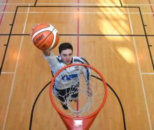 Taiaroa Porima-Flavell slams downs a basket at the Otago Boys' High School gym yesterday. The 17...