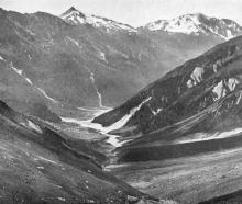 A view near the head of the Wills Valley, showing the mountain grandeur of South Westland. -...