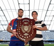 Harbour captain Charles Elton (left) and Southern captain Josh Walden get an early touch of the...