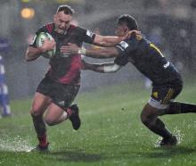 Israel Dagg of the Crusaders is tackled by Waisake Naholo of the Highlanders. Photo: Getty