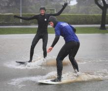 Oamaru siblings Thompson (16) and Aynsley (18)  Martin take advantage of a flooded Awamoa Park...