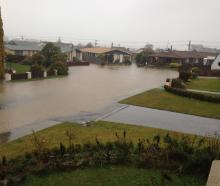 Otter Street in Oamaru has flooded. Photo: Hayden Meikle