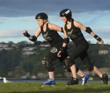Roller derby skaters Charmaine Reveley (left) and Mel Huddy race along Portsmouth Dr in Dunedin...