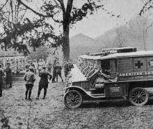 America co-operating with the Allied armies in France: a huge contingent of Red Cross ambulances...