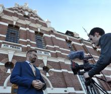 Abacus Multimedia producer Paul Dobson (left), of Sydney, is filmed by freelance cinematographer...