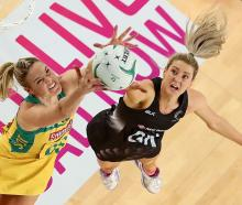 New Australian captain Caitlin Bassett (left) competes for the ball with Jane Watson during a...