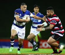 Daniel Bowden of Auckland makes a break during the round one Mitre 10 Cup match between Counties...