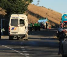 The minibus hit during yesterday's State Highway 1 crash near Palmerston sits damaged on the road...
