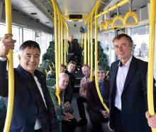Riding the bus are (from left) Dunedin Mayor Dave Cull, Otago Regional Council deputy chairwoman...