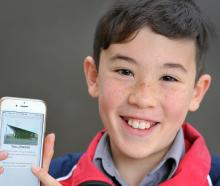 Taisei O'Sullivan Naito (11), opens the Dunedin trails app. Photo: Christine O'Connor