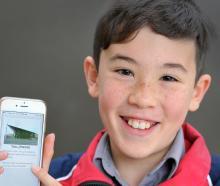 Taisei O'Sullivan Naito (11), opens the Dunedin trails app. Photo: Christine O'Connor
