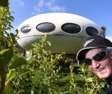 Caretaker John Tomlins with the Warrington spaceship house. Photos: Stephen Jaquiery