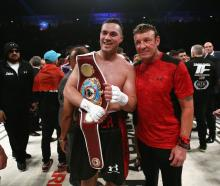 Joseph Parker with trainer Kevin Barry after his title defence against Hughie Fury. Photo: Reuters
