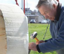 Dunedin sculptor Craig McLanachan works on a piece at the Oamaru Stone Symposium at Friendly Bay...