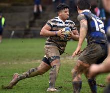 Otago Boys' High School first XV hooker Abraham Pole runs with the ball against Christchurch Boys...
