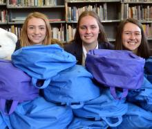 Otago Girls' High School business studies pupils (from left) Alice Fry (16), Emma Dixon (16), ...