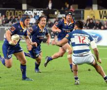 Otago second five-eighth Tei Walden looks to go past his opposite George Moala with prop Aki...