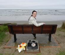 Sarah Baker sits on the memorial seat for her brother, Riley, near Shag Point yesterday. Photo:...