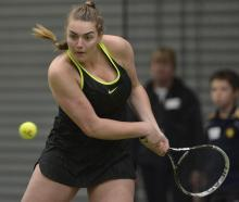 Megan Rogers (19) prepares to play a backhand during her Otago indoor open women's final against...
