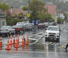 Cones are in place at a Caversham intersection on Monday  after a traffic island was ripped out....