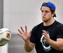 Otago second five-eighth Tei Walden takes a pass during training at the Edgar Centre earlier this...