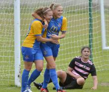 Southern United players Renee Bacon (left) and Ellie Issac after scoring against Northern at...