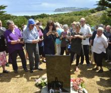 Relatives of those killed at the Seacliff Lunatic Asylum fire of 1942 view a  plaque unveiled on...