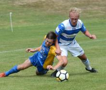Southern United's Tom Connor (left) and Tasman United's Kieran Smith battle for possession in...