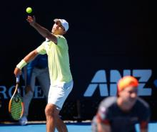 Queenstown's Ben McLachlan serves in his first-round doubles match at the Australian Open in...