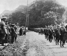 New Zealanders march past General Sir H. Horne during a service to mark the beginning of the...