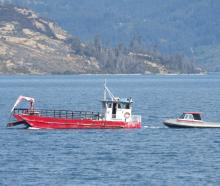 A barge and small boat were used to set up specialised sonar equipment yesterday in the hope of...