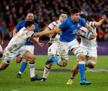 Italy's Sebastian Negri in action with France's Remy Grosso during the France and Italy Six...