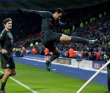 Chelsea's Pedro celebrates after scoring their second goal against Leicester. Photo: Reuters
