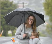 Wakari resident Andrea Irvine and daughter Beth (4) stand at an area of Lynn St, near Wakari...
