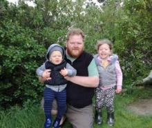 Simon with his children Chloe, 4, and Angus, 2. Photo: supplied via NZ Herald