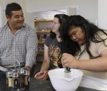 Sara Cohen School principal Matthew Tofia makes pizza and wedges with pupils (from left) Jazz...